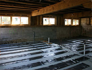 Low-voltage electric floor heating system being installed.