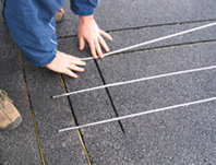installation of heated driveway systems snow melting systems Driveway Ice Melt Systems asphalt driveway retrofitted with radiant snow melting cable